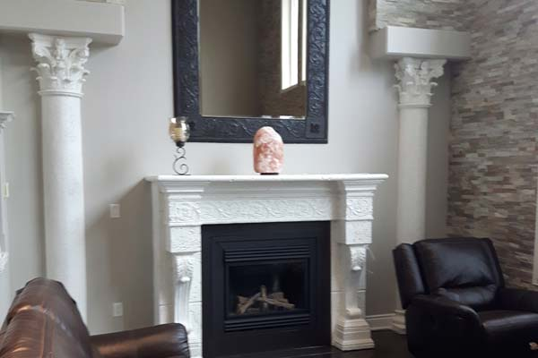 White painted columns and fireplace