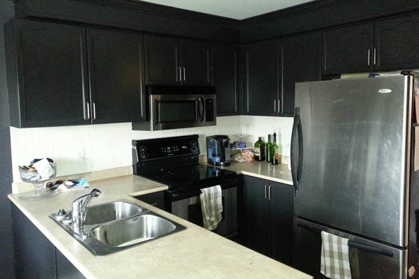 Kitchen cabinets painted with a fresh black paint