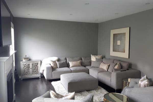 modern looking living room painted with grey walls
