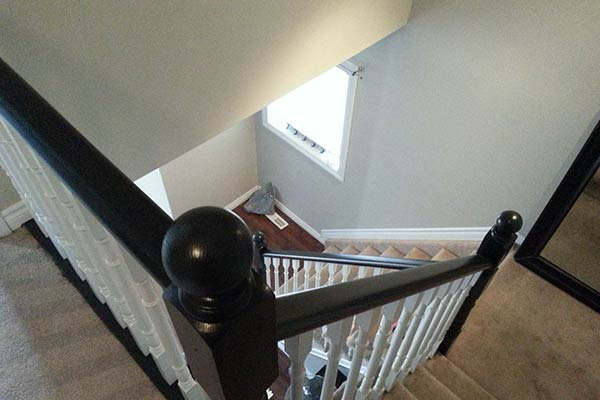 Stairs with white spindles and black stained tops