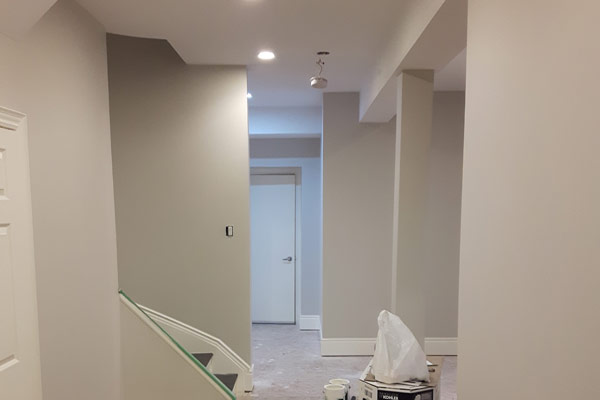 Basement finished with light colours and white ceiling.