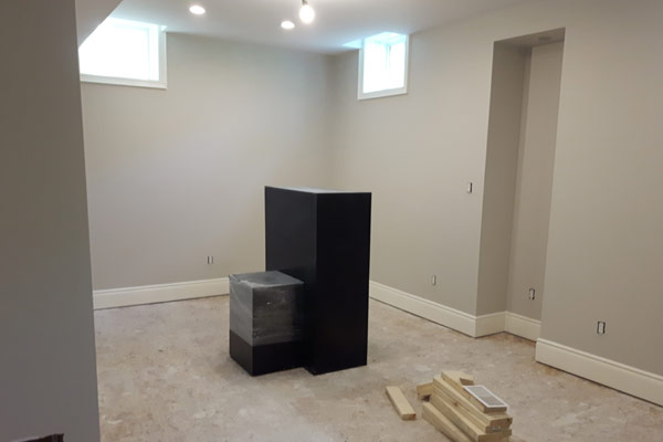 basement rool with white baseboards