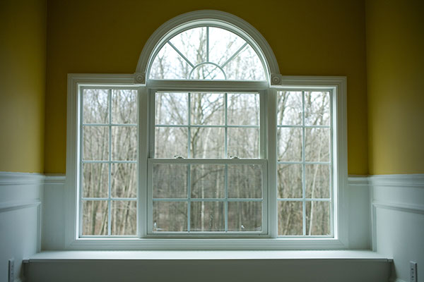 Window with white trims and mustard colour painted walls